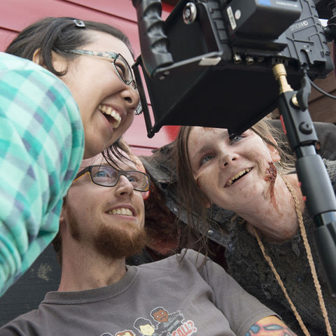 Judith Chan, Mat Johns and Hazel Gibson crowd around the monitor to review the lastest take.