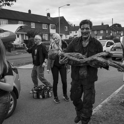 Garth Maunders assists the art department by carrying a skeleton prop to the next location.