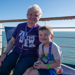 The oldest and youngest Leap Year Babies aboard the cruise enjoy a spot of sunshine.