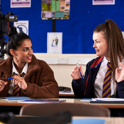Payal Mistry and Kelsey Openshaw chat between takes.