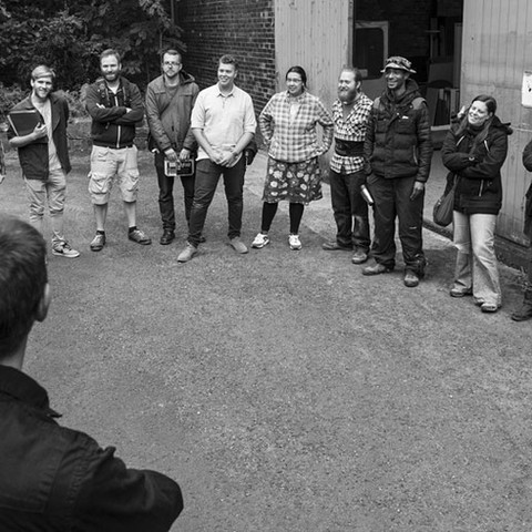 The cast and crew assemble for a safety briefing.