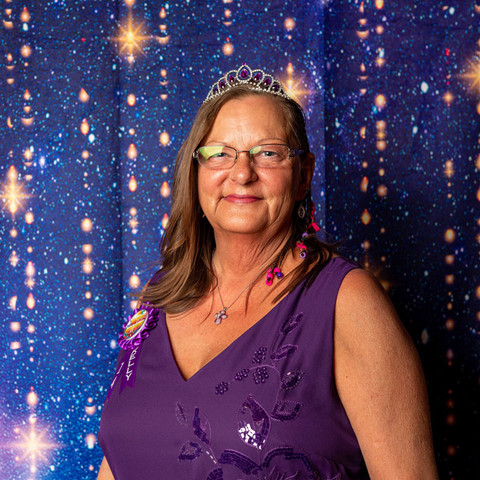 Kelly poses for the camera in a tiara.