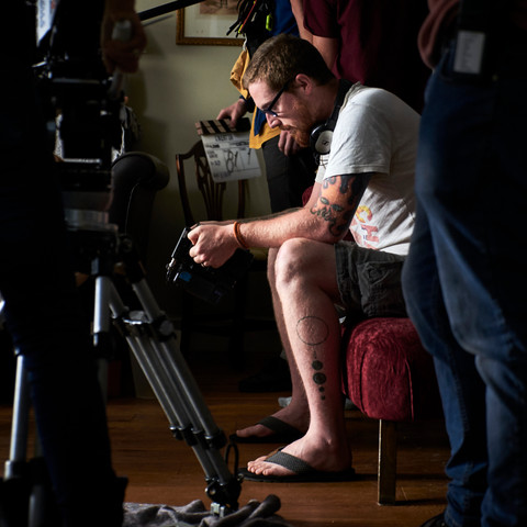 Mat Johns watches a scene unfold on the director's monitor.