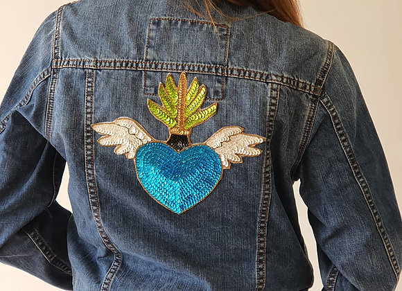 Cazadora joya corazón alado azul