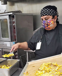 Woman working in an industrial kitchen