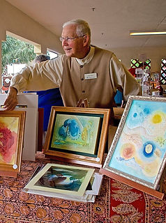 Man selling paintings at Festival