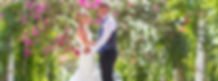 Bride and grrom at flower arch in ayia napa