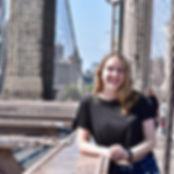 Saoirse smiling on a bridge