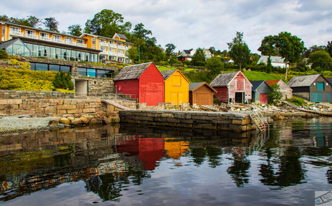 boathouses mirroring in the water