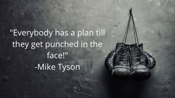 Boxing gloves with Mike Tyson quote