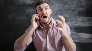 White man very upset while on a phone call.