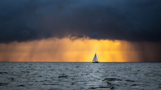 Small sailboat on the sea after a large storm.