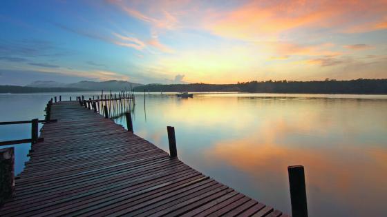 Lake dock overlooking sunset.