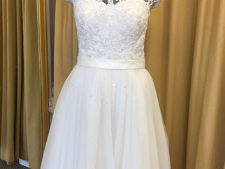 Was £720 now £360 a tea length dress in tule and lace.
