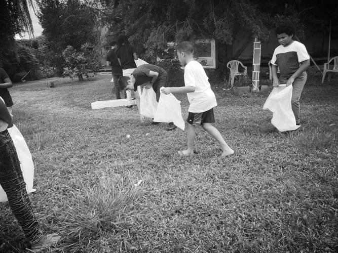 Adinkra Nola Group Cleaning Neighborhood