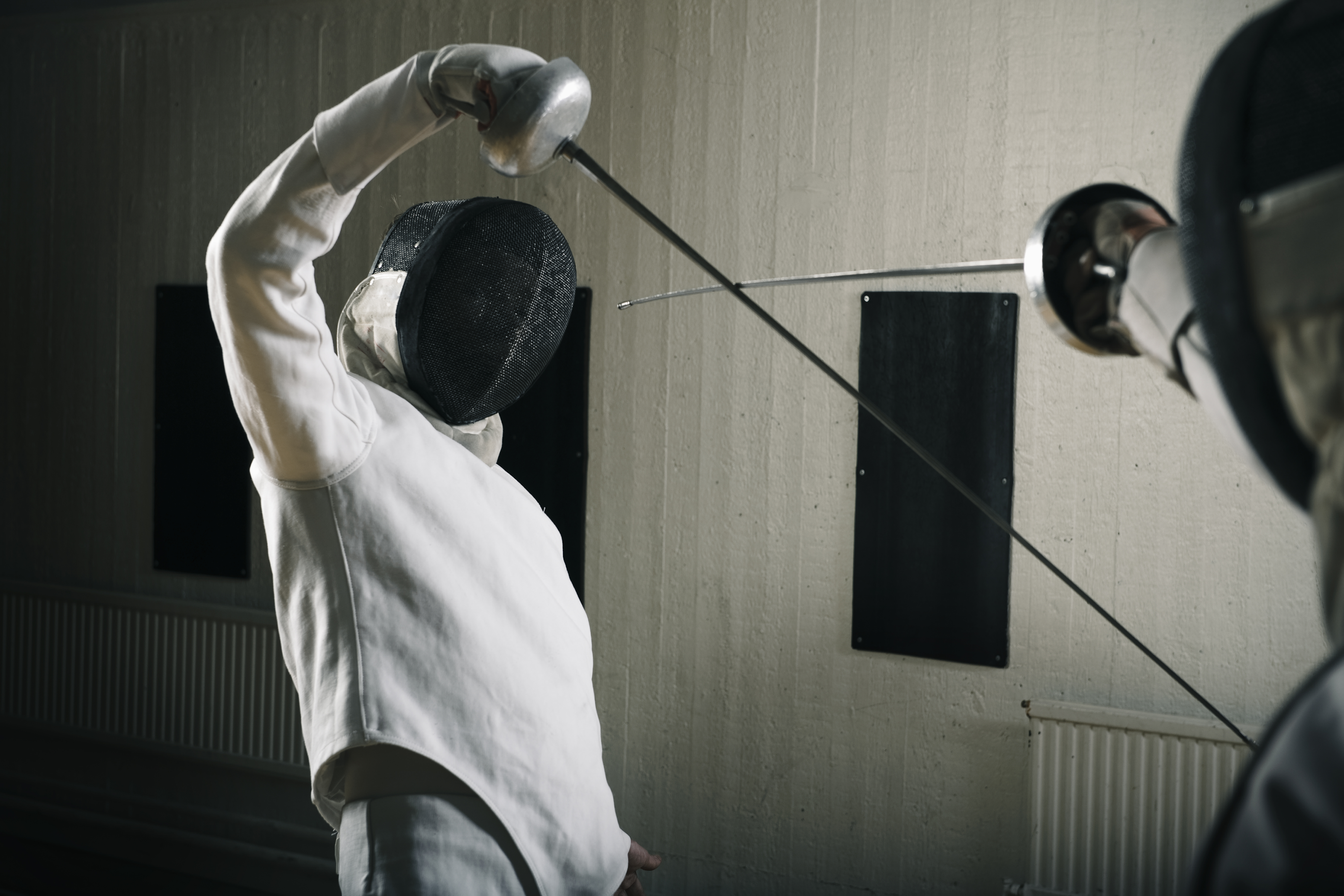 Fencers in combat