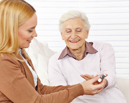 CARE PROVIDER WITH OLDER WOMAN