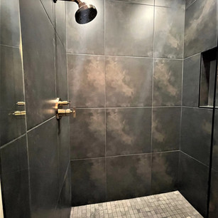 Black and gold walk in shower