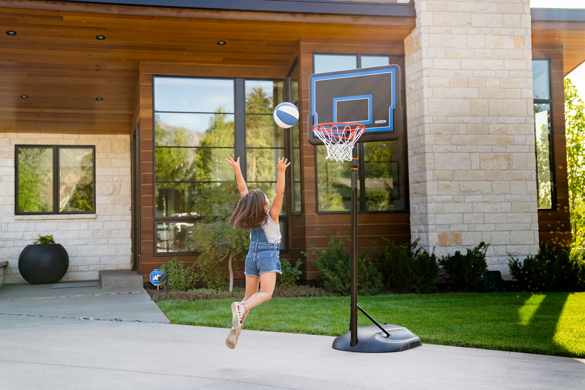 Girl Playing on Lifetime Basketball Hoop