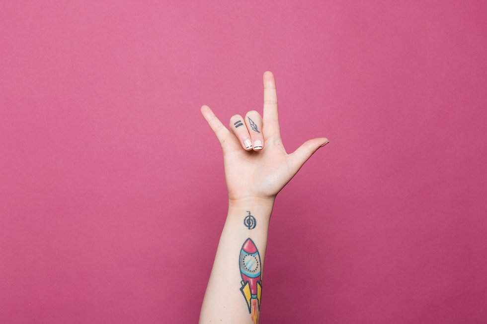 a-tattooed-hand-doing-the-sign-for-i-lov
