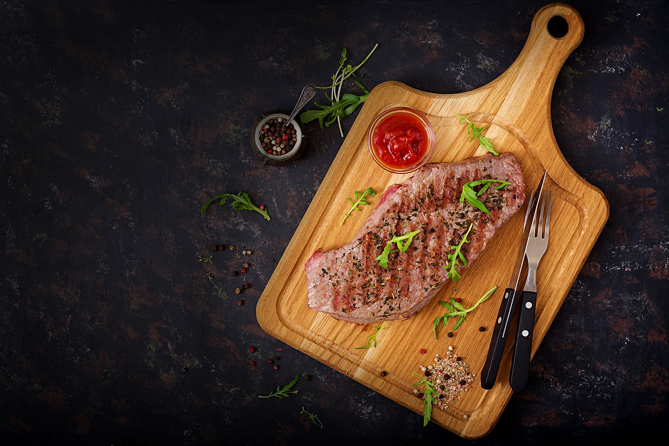 juicy-steak-rare-beef-with-spices-on-a-w