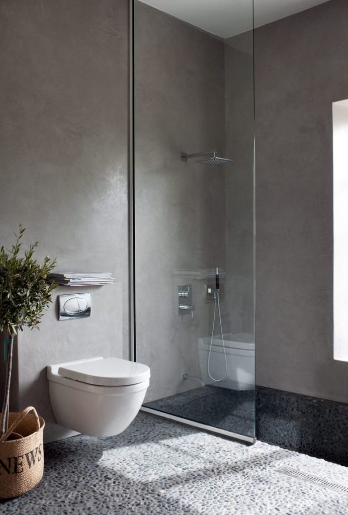 MICROCEMENT ACCENT WALLS IN MASTER BATHROOM