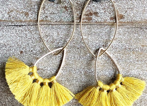 Mustard Fan Tassel on Gold Oval