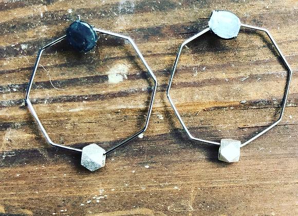 Matte silver bead on silver hexagon