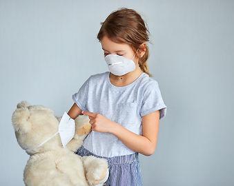little-girl-holding-hugging-teddy-bear-m