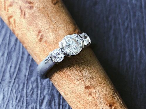 The Three-Stone Semi-Bezel Diamond Ring