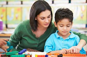 teacher-assistant-with-autisim-student.j