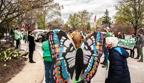Woman from the back with colorful butterfly wings