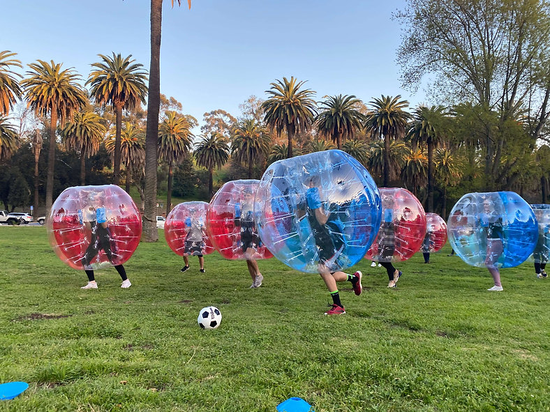 park playing human bubble ball soccer