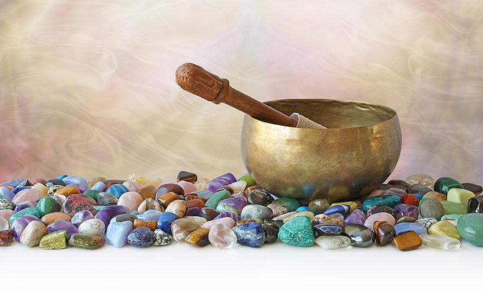 Tibetan Singing Bowl surrounded by tumbl
