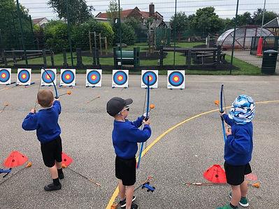 Children trying archery