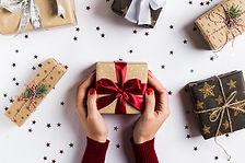 woman-hands-holding-christmas-holiday-gi