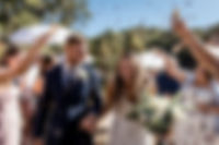 Bride and Groom walking down aisle being showered in natural confetti