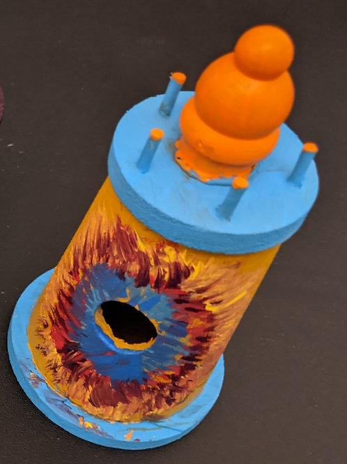 orange and blue lighthouse birdhouse