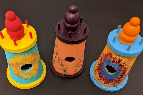 trio of wooden lighthouse birdhouses