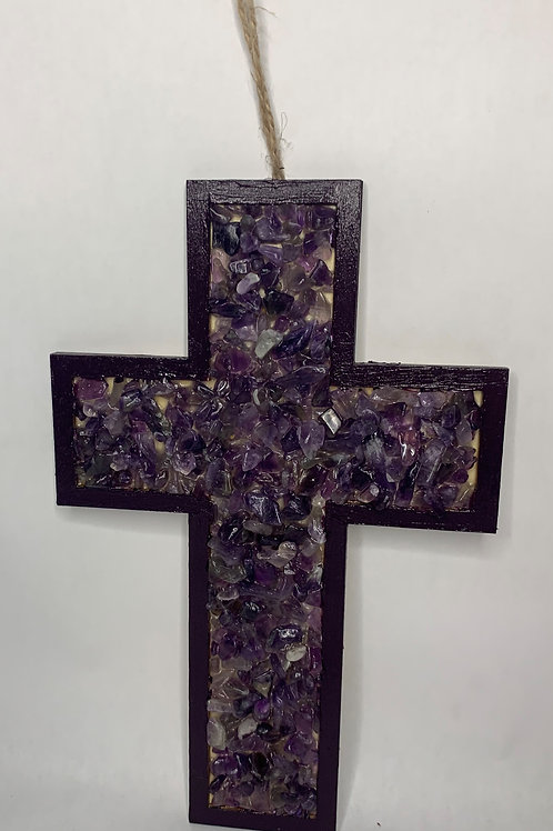 wooden cross with purple stones