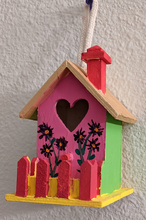 red fence birdhouse