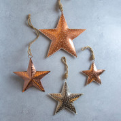 32. Copper or silver star decorations