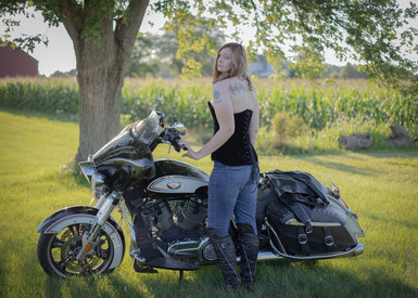 Young lady and a motorcycle
