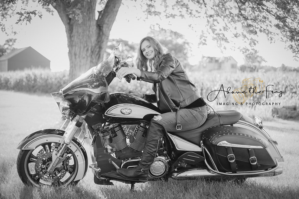 Local Dayton photographer shoots country session with motorcycle and young lady.