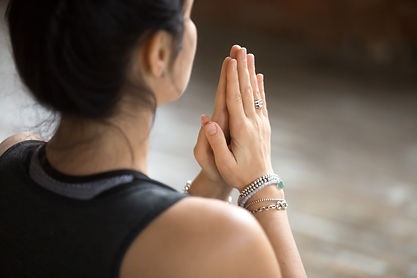 Namaste gesture close up photo, young at