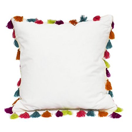 white pillow with colorful tassles