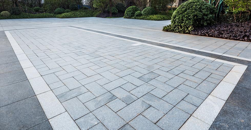 Grey marble floor tiles on garden square