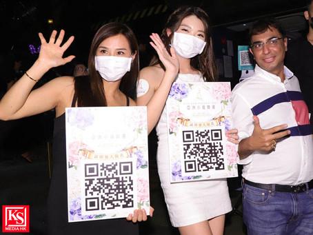 《亞洲小姐競選2021》口罩派發及招募活動一眾亞洲小姐到蘭桂坊派發口罩提醒公眾防疫意識並呼籲女士們踴躍報名參加