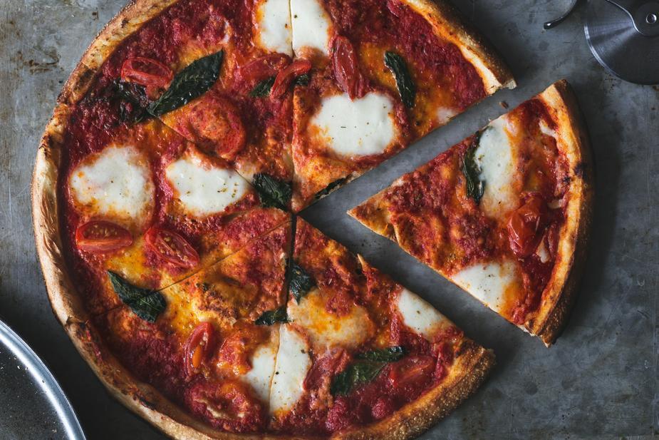 first-slice-of-fresh-margarita-pizza_925