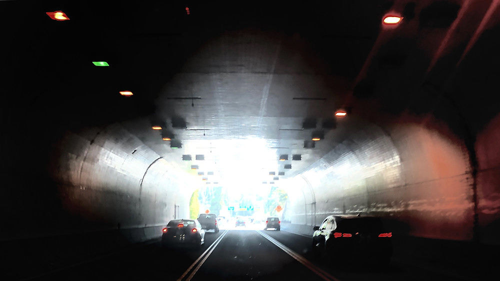 photo of cars in tunnel on freeway